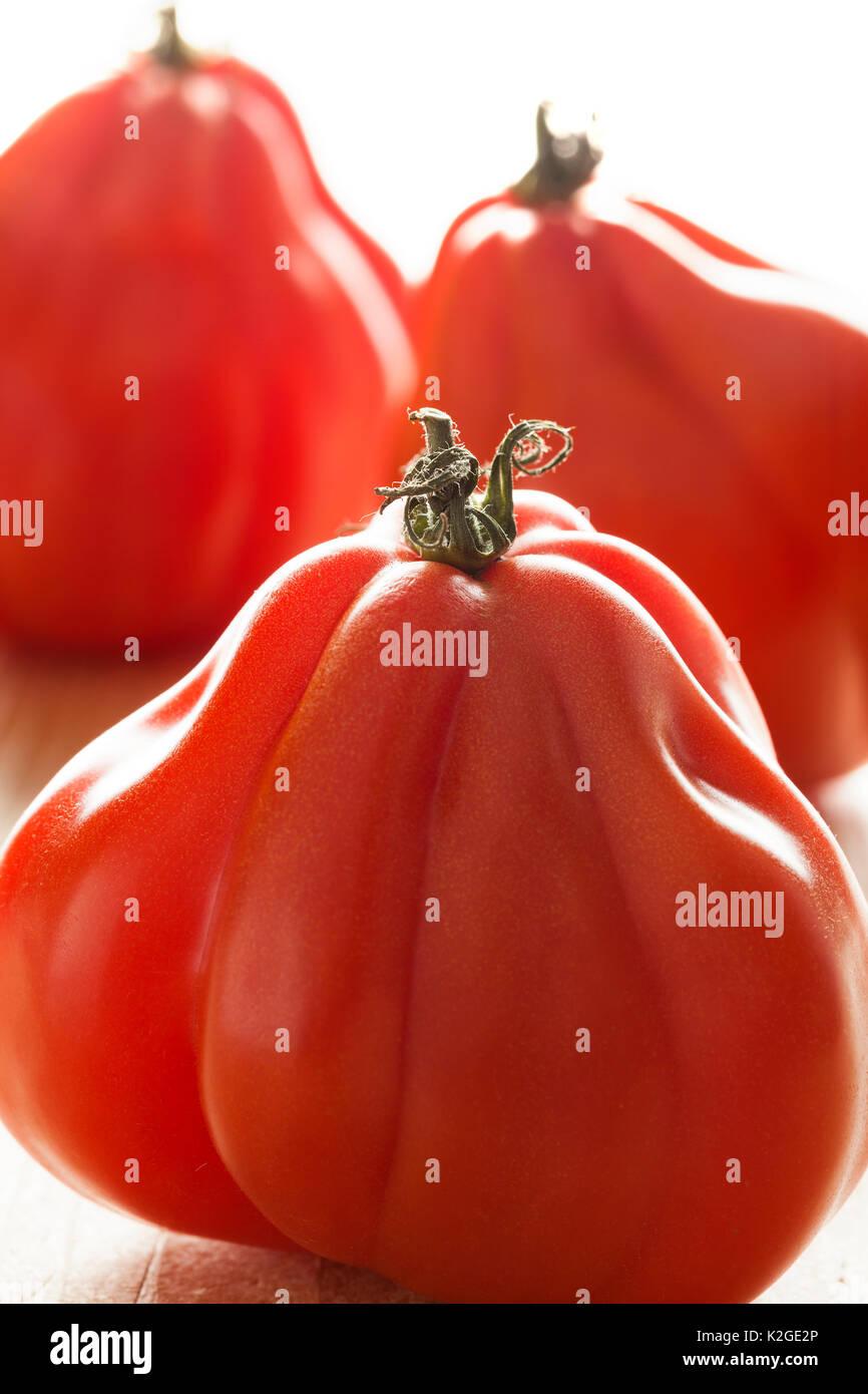 Coeur de Boeuf tomatoes close up - Stock Image