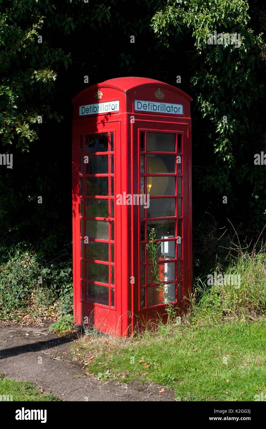 Defibrillator telephone box, Barnacle, Warwickshire, England, UK - Stock Image