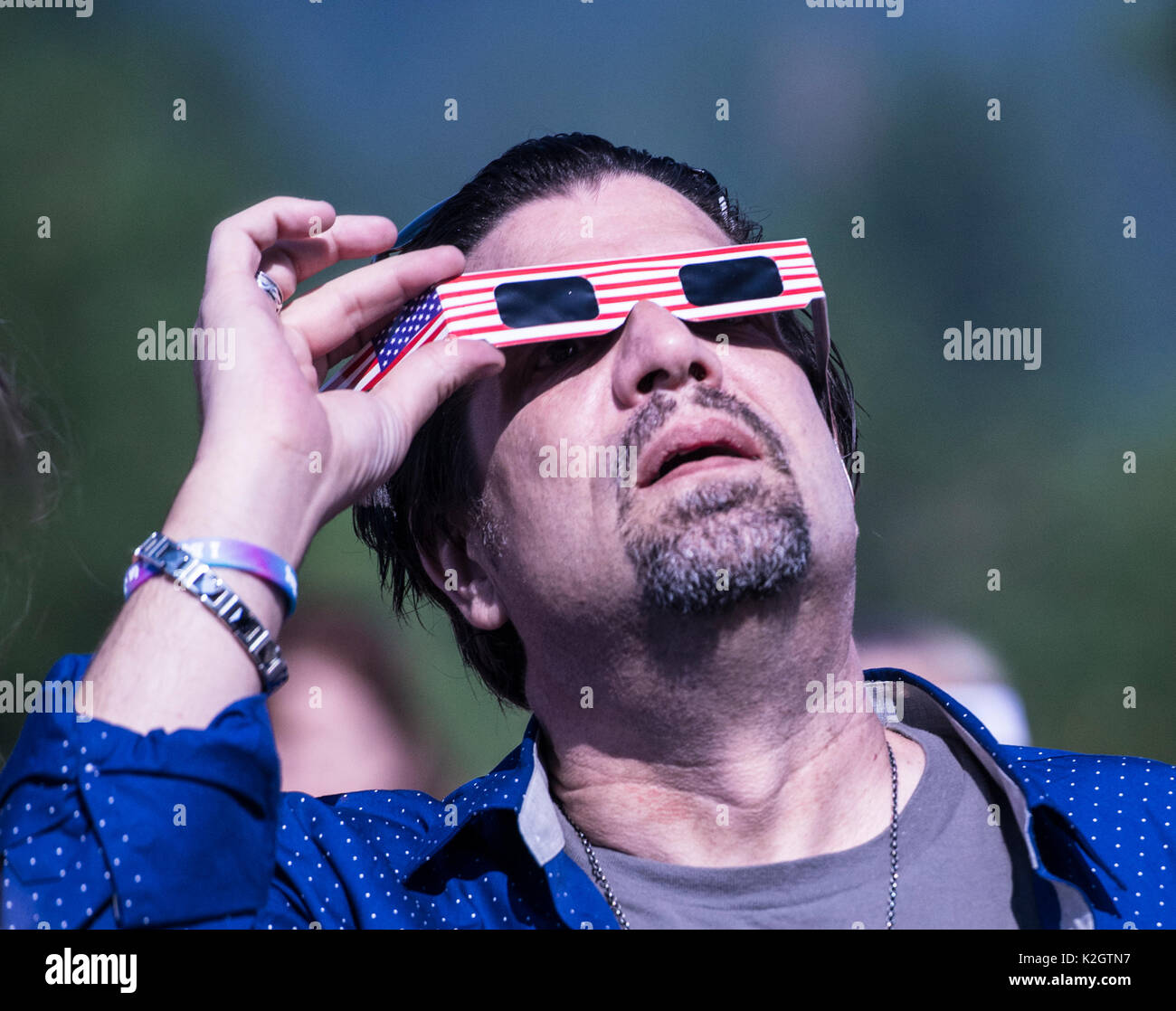Celebrity and Radio host of Fade to Black watches the 2017 eclipse at the Eclipse of Disclosure Conference in McCloud, California, near Mt. Shasta. - Stock Image