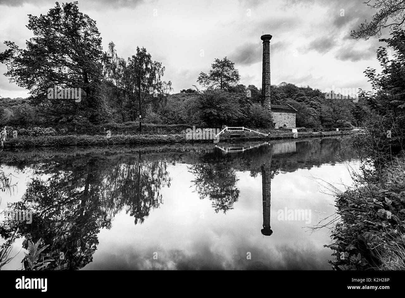 Leawood Pumphouse at Cromford Canal in Derbyshire on the edge of the Peak District. This is a  black and white image capturing a beautiful reflection. - Stock Image