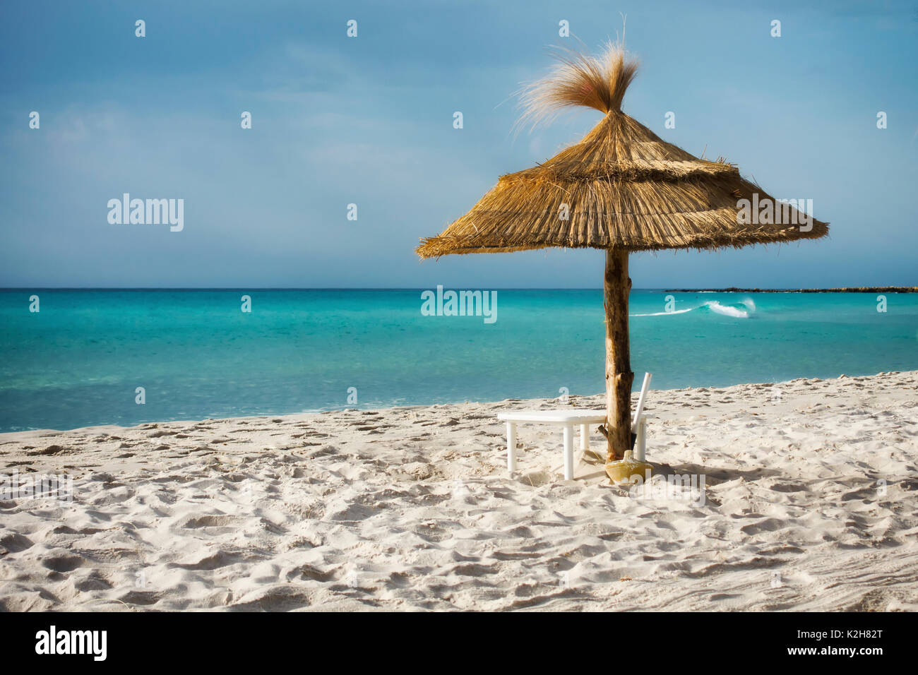 tropical beach and turquoise sea - Stock Image