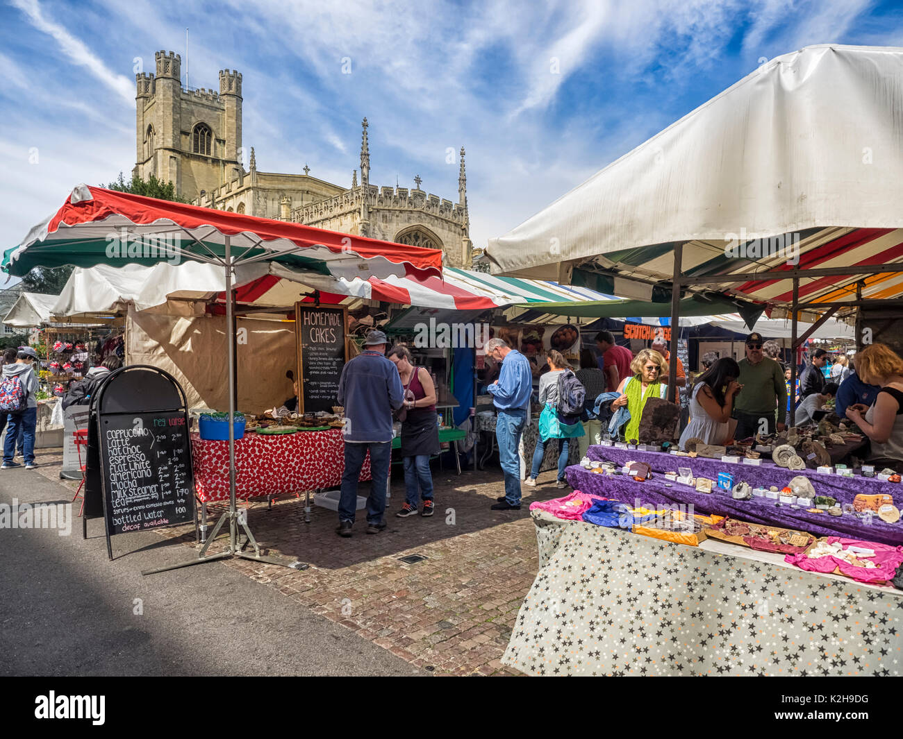 CAMBRIDGE, UK:  The Historic Market in Market Square with Great St Mary's Church  in the background - Stock Image