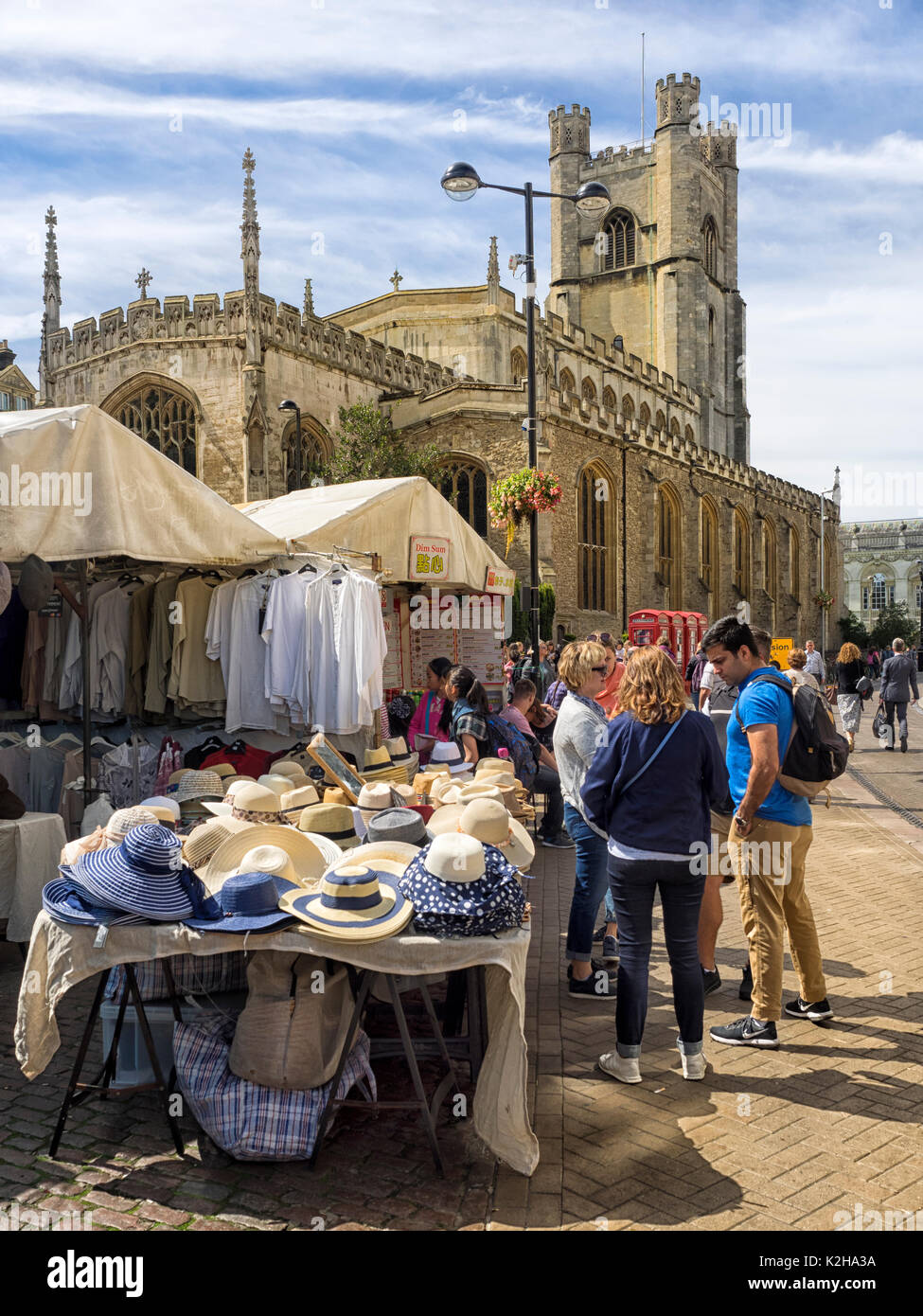 CAMBRIDGE, UK:  The Historic Market in Market Square overlooked by Great St Mary's Church - Stock Image