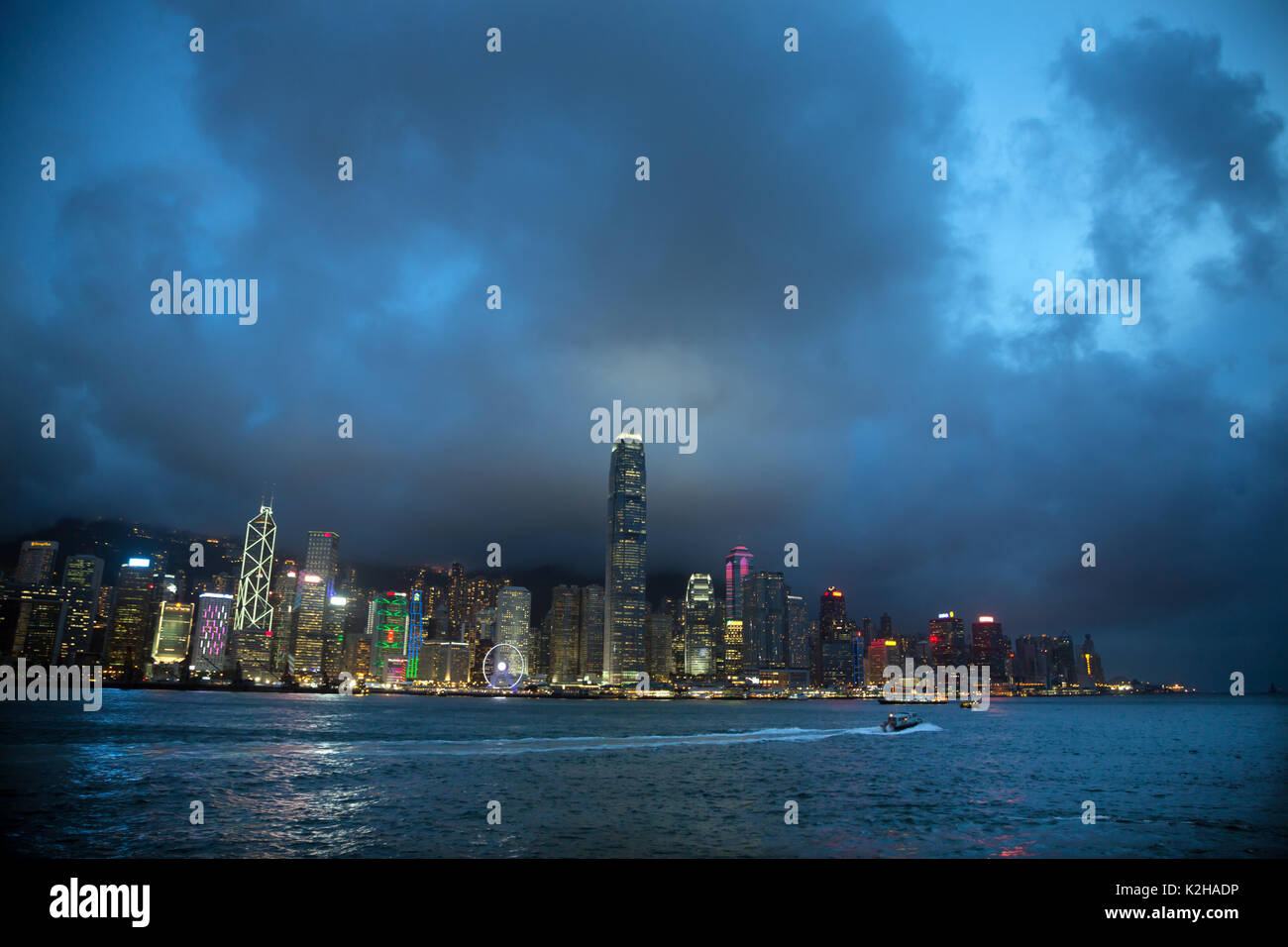 End of the day on the majestic Hong Kong skyline, seen from the Tsim Sha Tsui promenade. Stock Photo