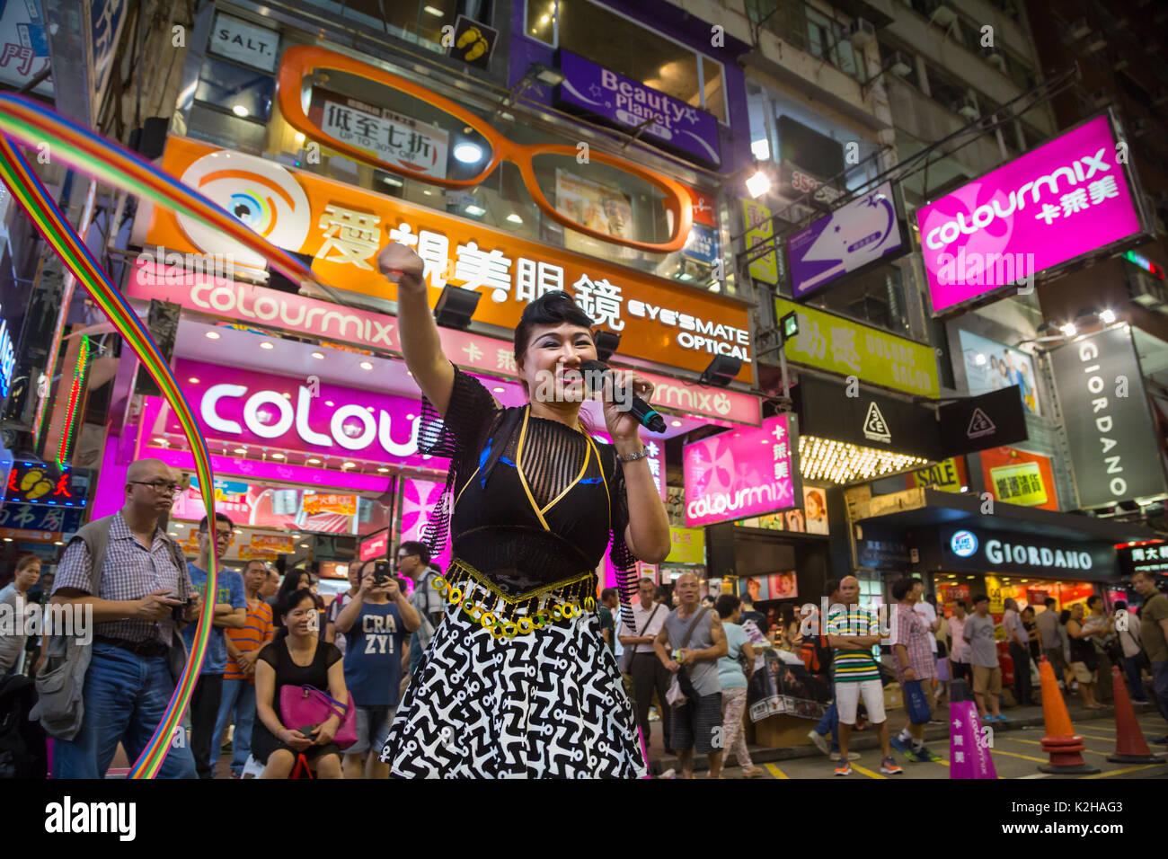Crowd during live performance in the streets of Mong Kok on a Saturday night. Stock Photo