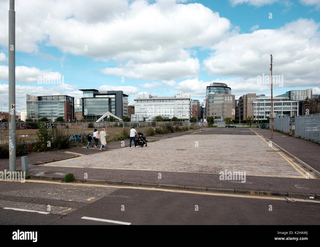 Undeveloped land besides the River Clyde on Tradeston Street in the run down area of Kingston Glasgow - Stock Image