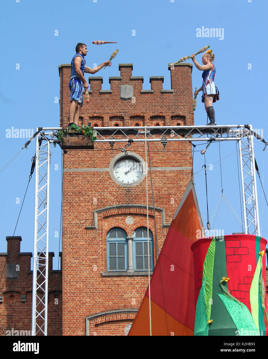AALST, BELGIUM, AUGUST 27 2017: The juggling and acrobatic duo Circus unARTiq perform outside Aalst station, during the free open air festival Cirk. C - Stock Image