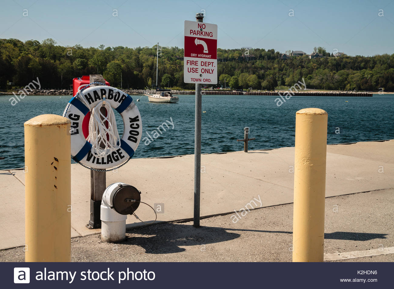 Life ring and fire water access at harbor, Egg Harbor, Wisconsin - Stock Image