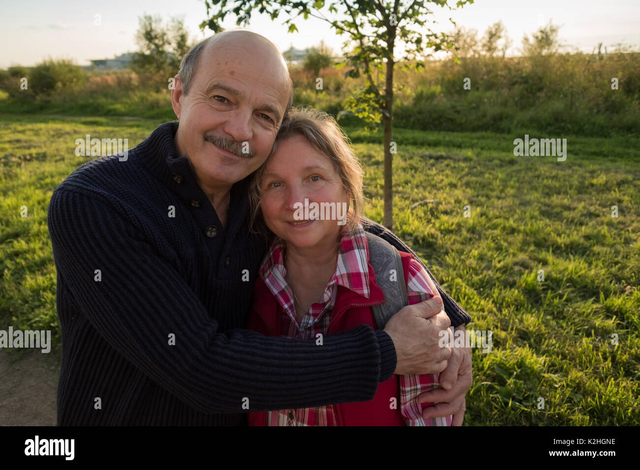 Portrait of mature couple looking at camera - Stock Image