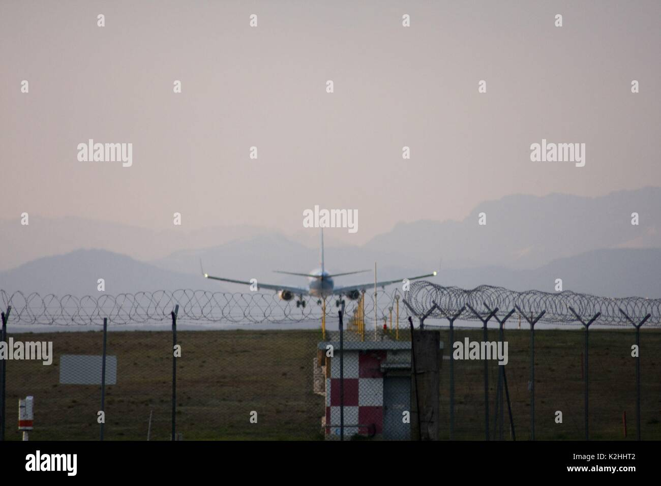Commercial jet prepares for landing in an italian airport Stock Photo