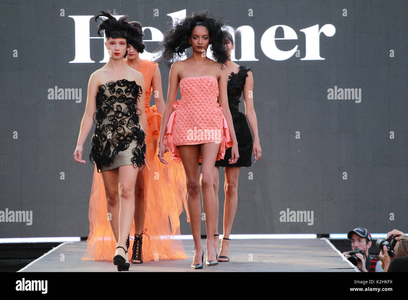 Montreal,Canada 25/08/2017.  four models walk on the runway at the Helmer fashion show held during the Fashion and Design Festival. - Stock Image
