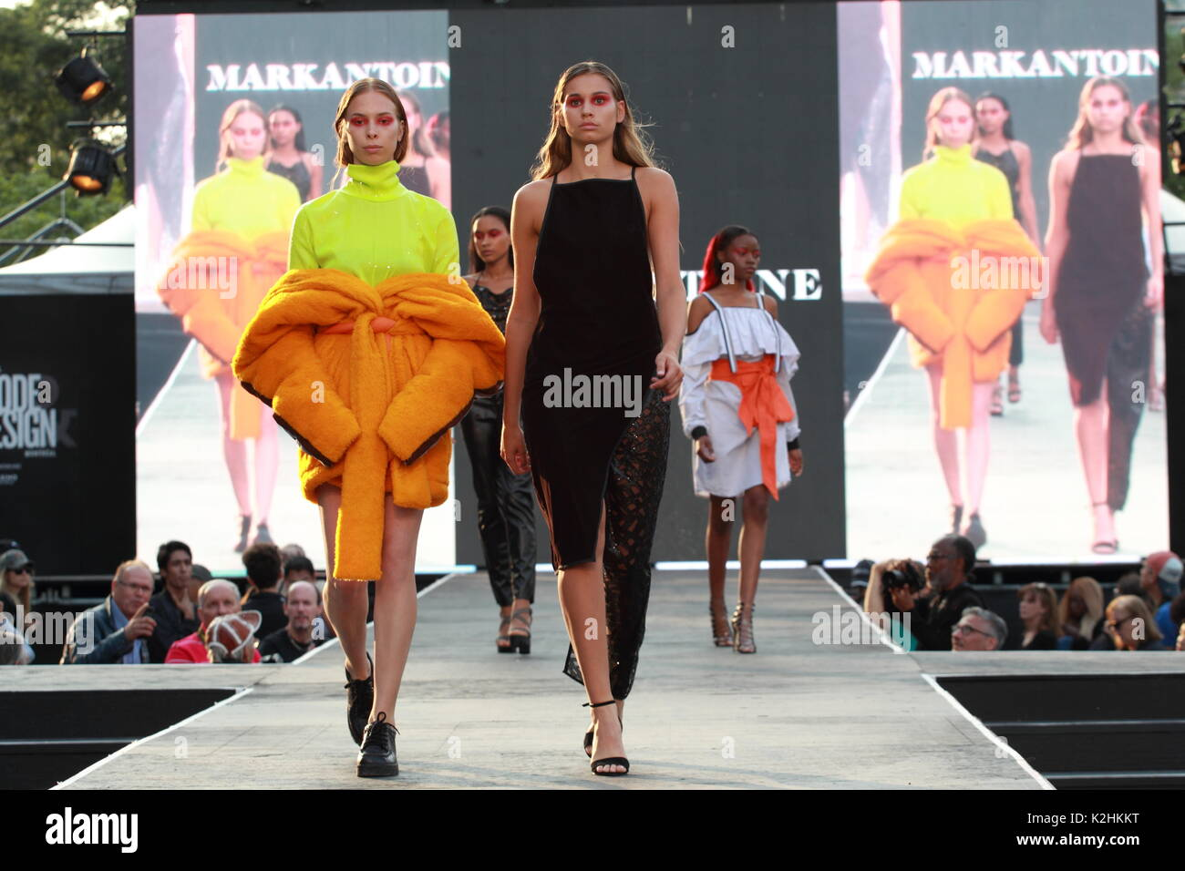 Montreal,Canada 25/08/2017.  Four models walk on the runway at the Markantoine fashion show held during the Fashion and Design Festival. - Stock Image