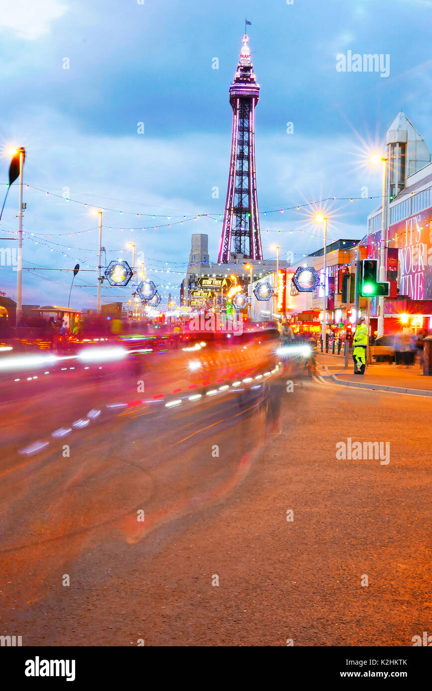 Light trails from bicycles riding along Blackpool Promenade in front of the Tower during the annual Ride the Lights Stock Photo