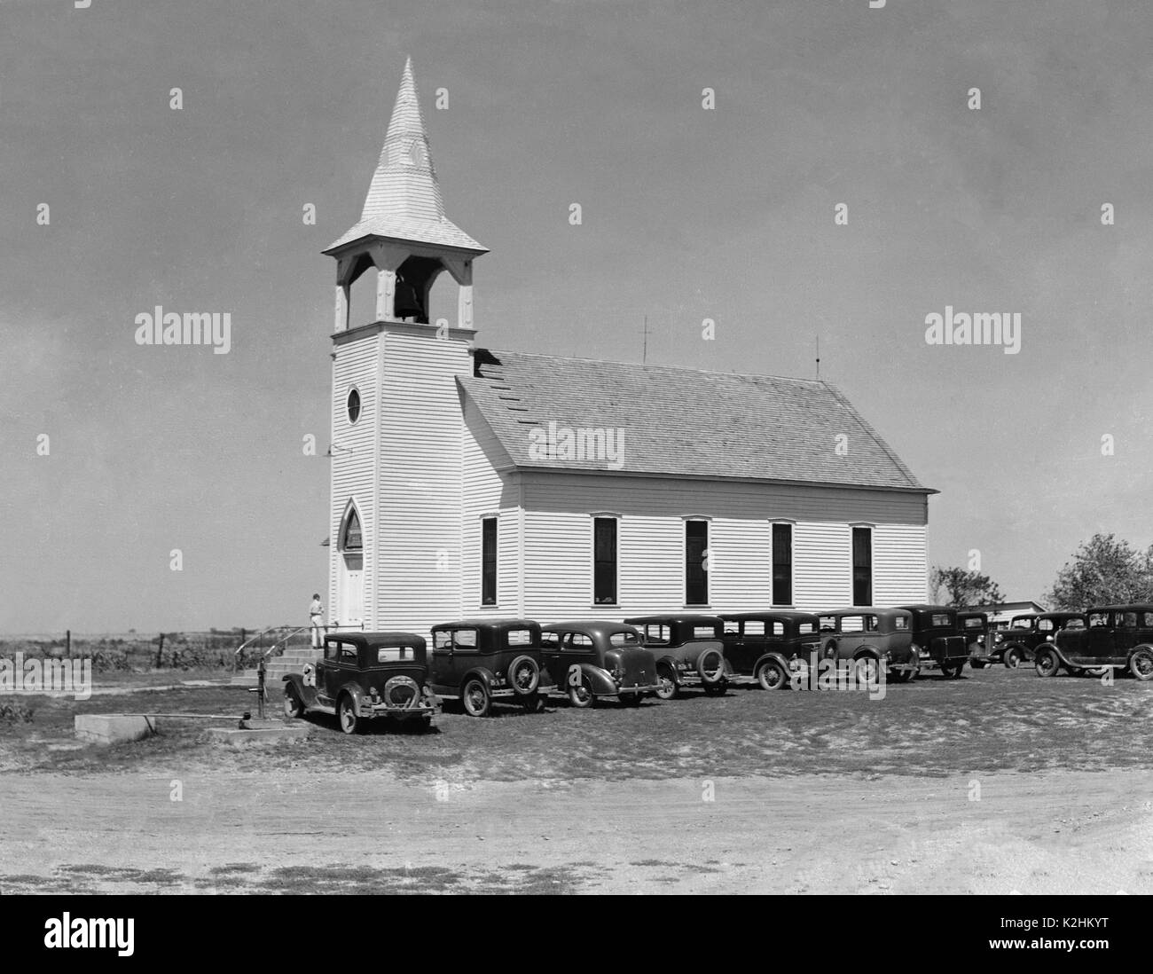 CHURCH WITH CARS PARKED IN FRONT - Stock Image