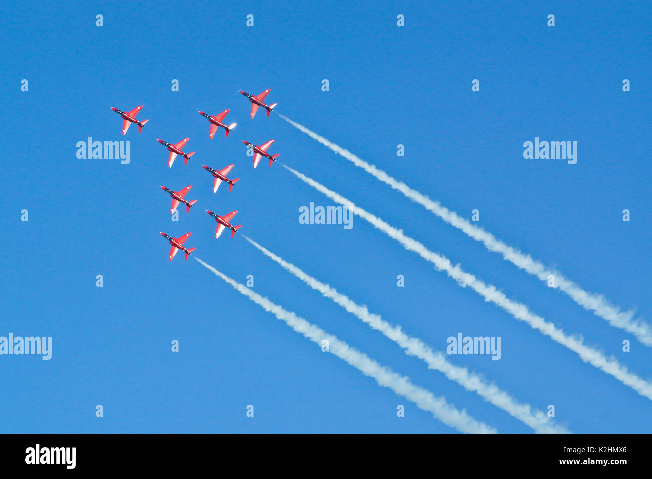 The Red Arrows in flight, Dawlish, UK - Stock Image