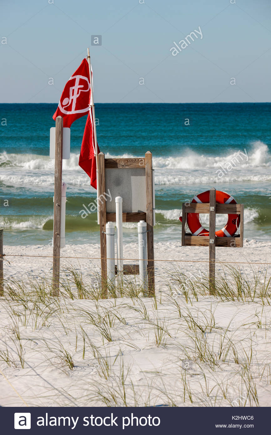 Double red flag swimmer warnings fly along north Florida gulf coast at Topsail Hill Preserve State Park, following major spring storm, restricting swi - Stock Image