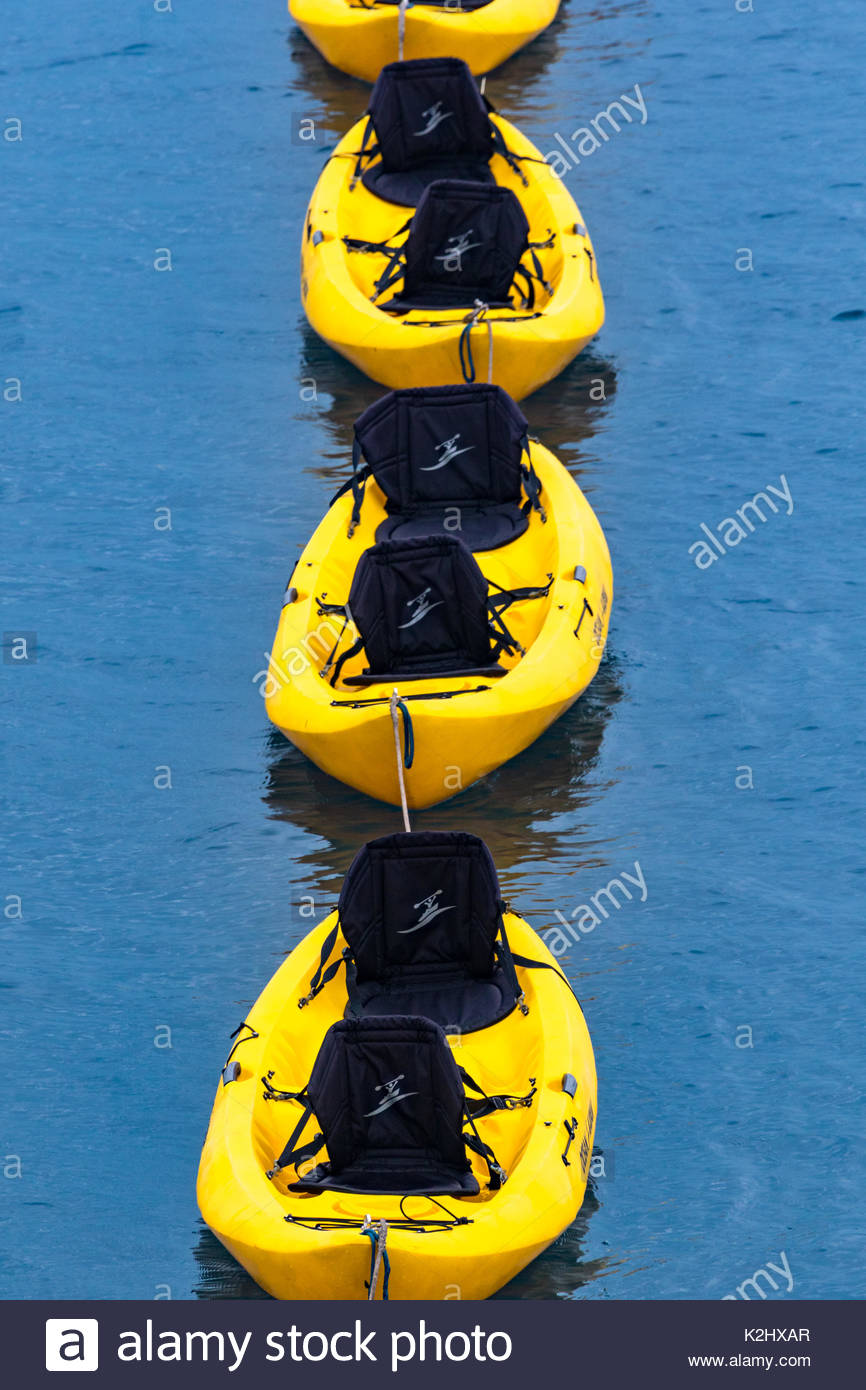 A line of sit on top kayaks waits for activity in Panama - Stock Image
