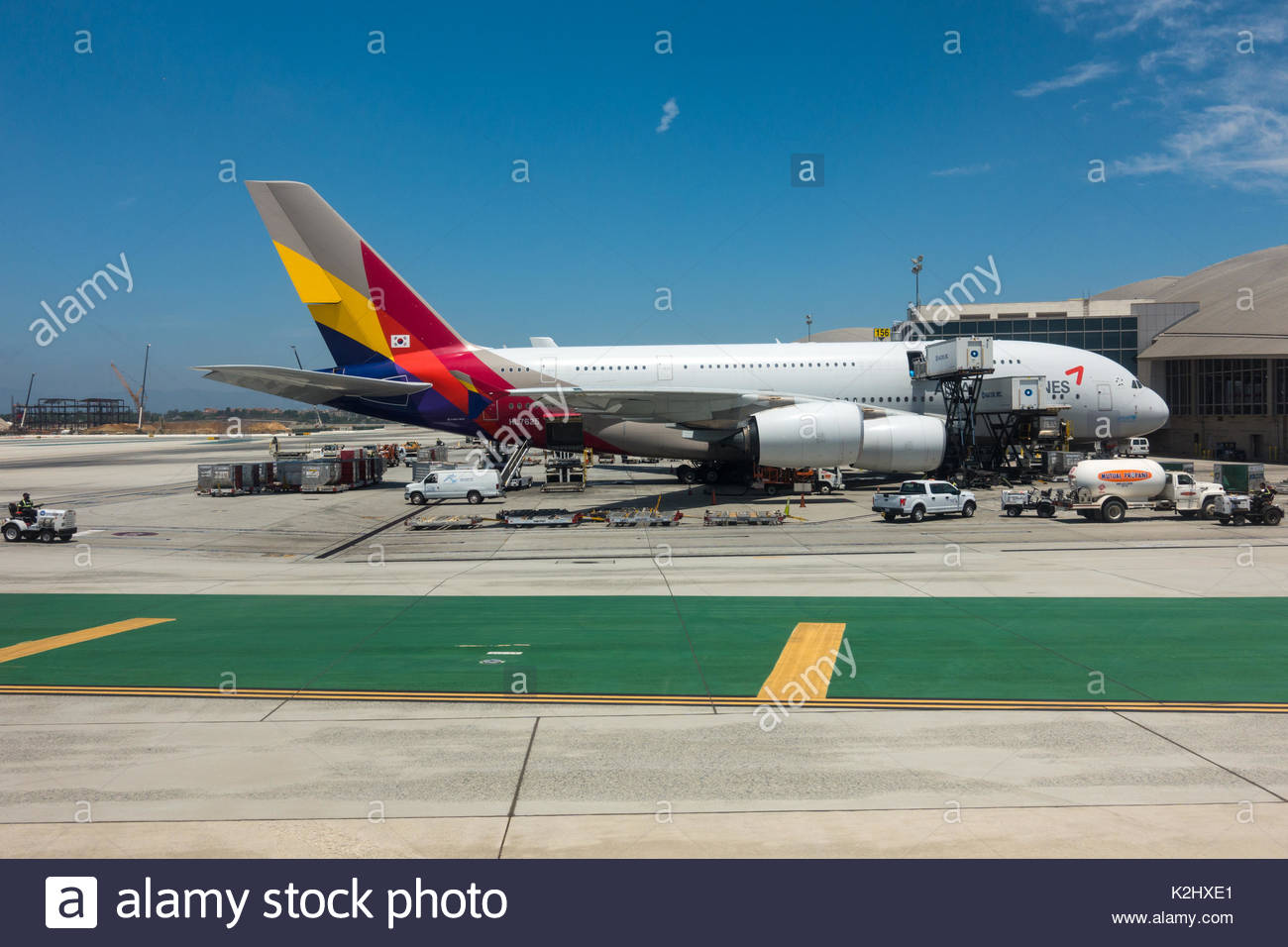 An Asiana Airlines Airbus A380 sits at the Bradley International Terminal of Los Angeles International Airport (LAX) - Stock Image