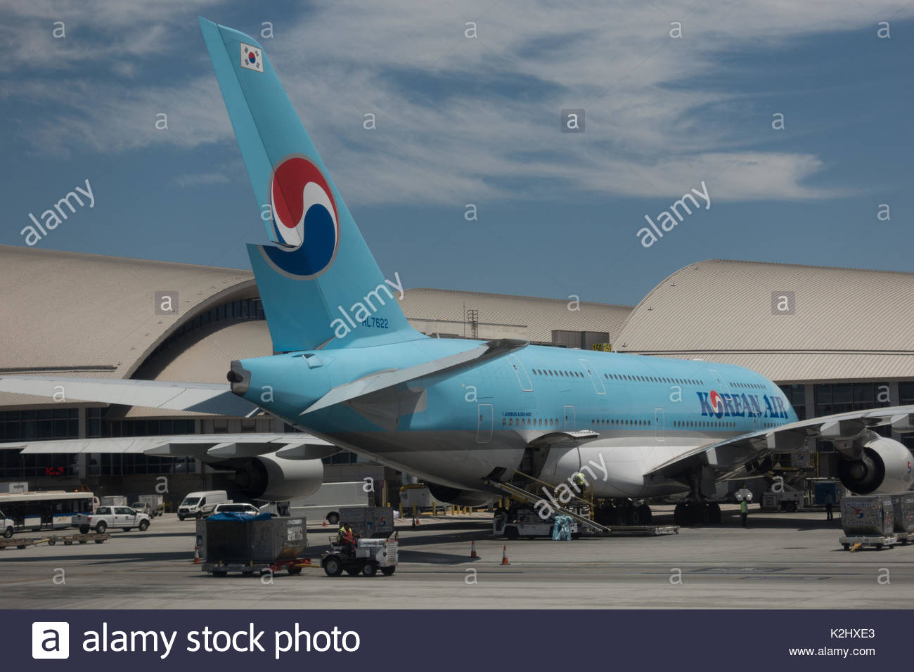 A Korean Air Airbus A380-861, tail number HL7622, sits at gate 150 of Los Angeles International Airport's Bradley International Terminal. - Stock Image