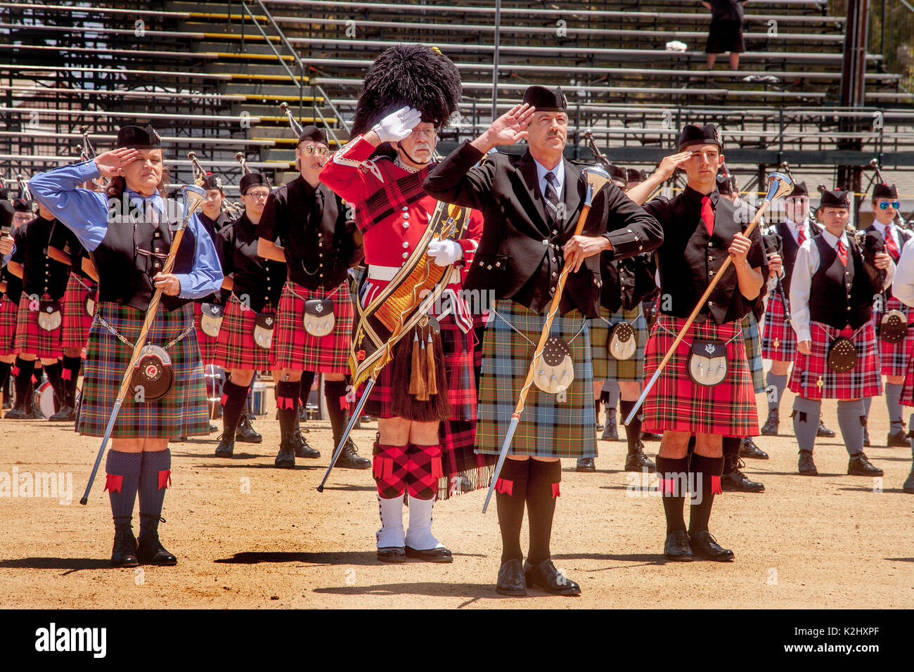 A kilted drum major carries his baton while leading a Scottish marching band at an ethnic festival in Costa Mesa, CA. - Stock Image