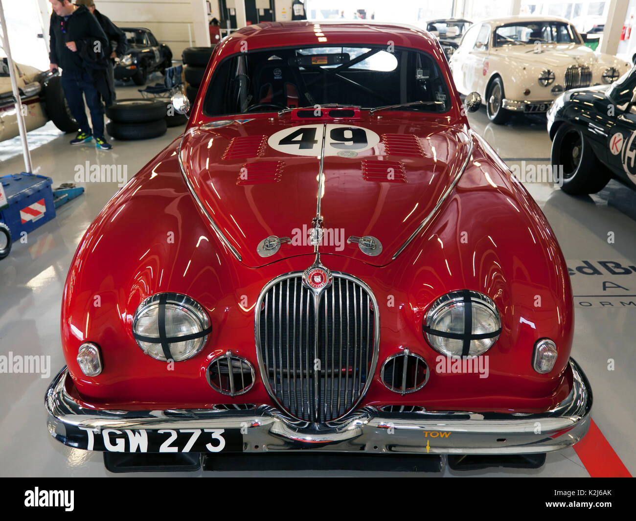 Front view of a  1959 Jaguar 3.4 Litre race car in the International Pits at the 2017 Silverstone Classic - Stock Image