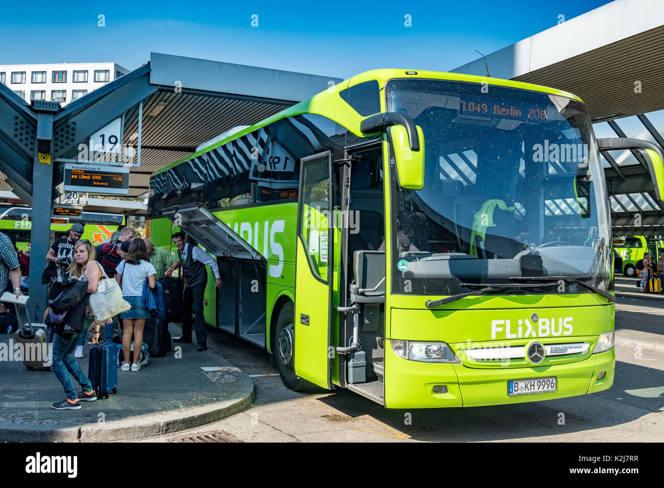 Passengers disembarking from Flixbus at Berlin coach station in Germany - Stock Image