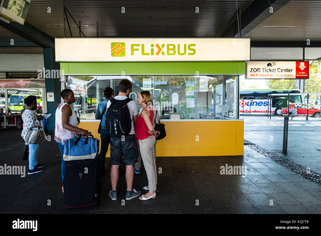 Flixbus ticket office with passengers queuing at Berlin coach station in Germany - Stock Image
