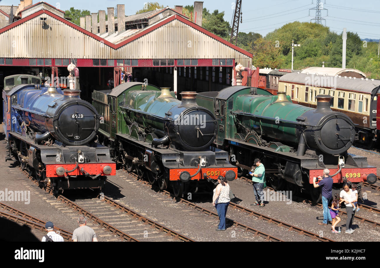 Stationary Steam Locomotive and Carriages on tracks outside their sheds at Didcot Railway Centre in England - Stock Image