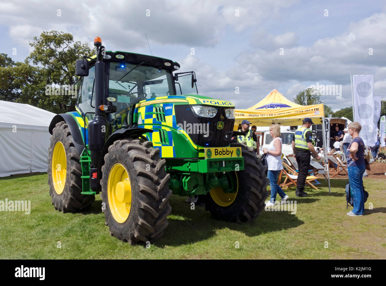John Deere tractor promoting the North Yorkshire Police Rural Task Force at Ripley Show North Yorkshire England UK United Kingdom GB Great Britain - Stock Image