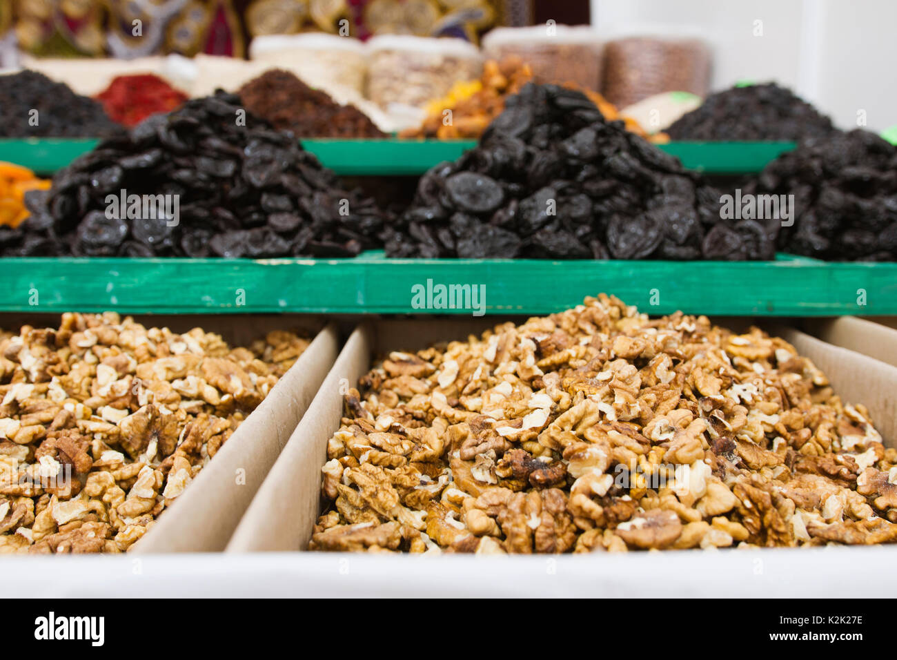 A lot of shelled walnuts on street marcet - Stock Image