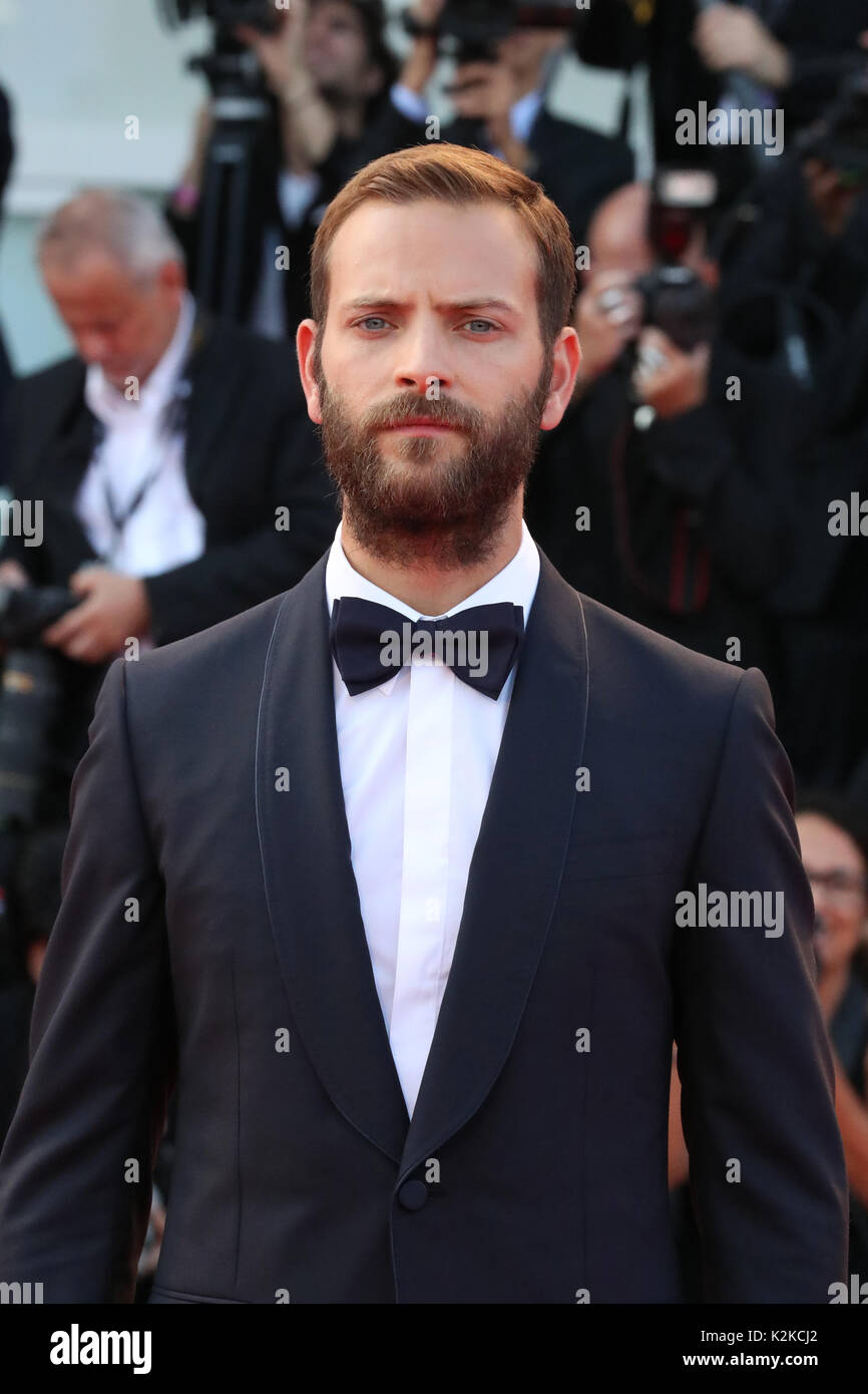 Venice, Italy. 30th Aug, 2017. VENICE, ITALY - AUGUST 30: Alessandro Borghi walks the red carpet ahead of the 'Downsizing' screening and Opening Ceremony during the 74th Venice Film Festival at Sala Grande on August 30, 2017 in Venice, Italy. Credit: Graziano Quaglia/Alamy Live News - Stock Image