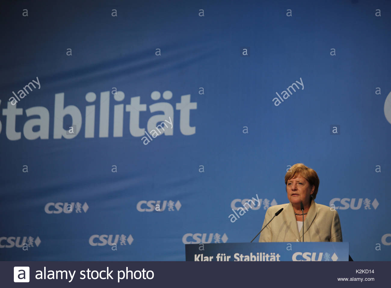 A determined look on Angela Merkel's face as she speaks to a large crowd on the campaign trail in the run up to the German election which is taking place on Sunday, September 24.Merkel spoke for over forty minutes and was well received though a small group of protestors tried to interrupt her speech with whistles and catcalls. - Stock Image