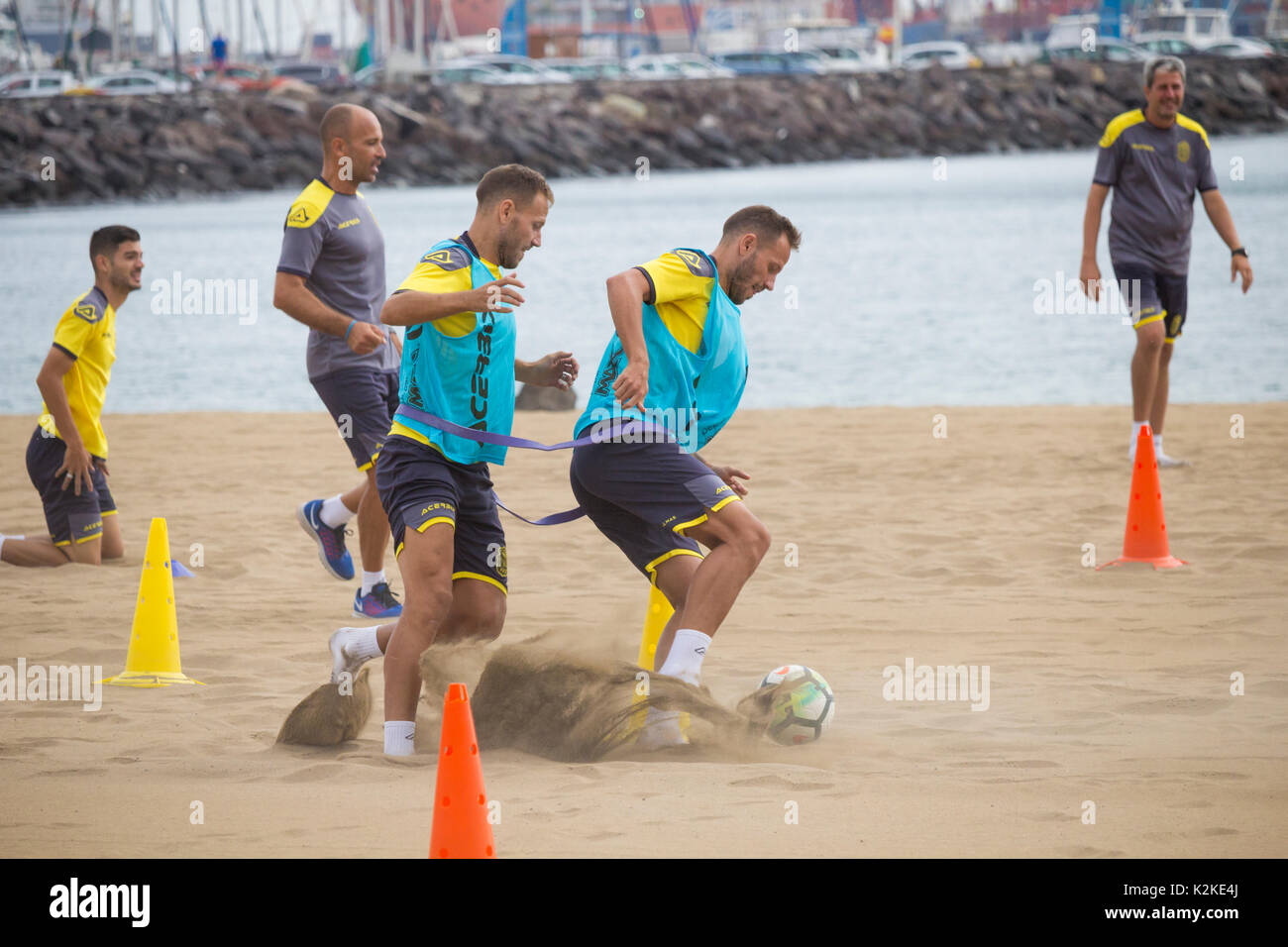 Las Palmas, Gran Canaria, Canary Islands, Spain. 31st August, 2017. With Chelsea striker Loic Remy rumoured to be close to signing for Spanish La Liga team, Las Palmas, the Las Palmas players have a morning training session on one of the city beaches in Las Palmas, the capital of Gran Canaria. - Stock Image