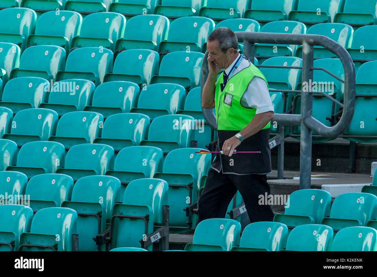 31 August 2017, London, UK. An arrow which was shot onto the pitch is carried by a steward at the oval and the crowd  is evacuated. David Rowe/ Alamy Live News - Stock Image