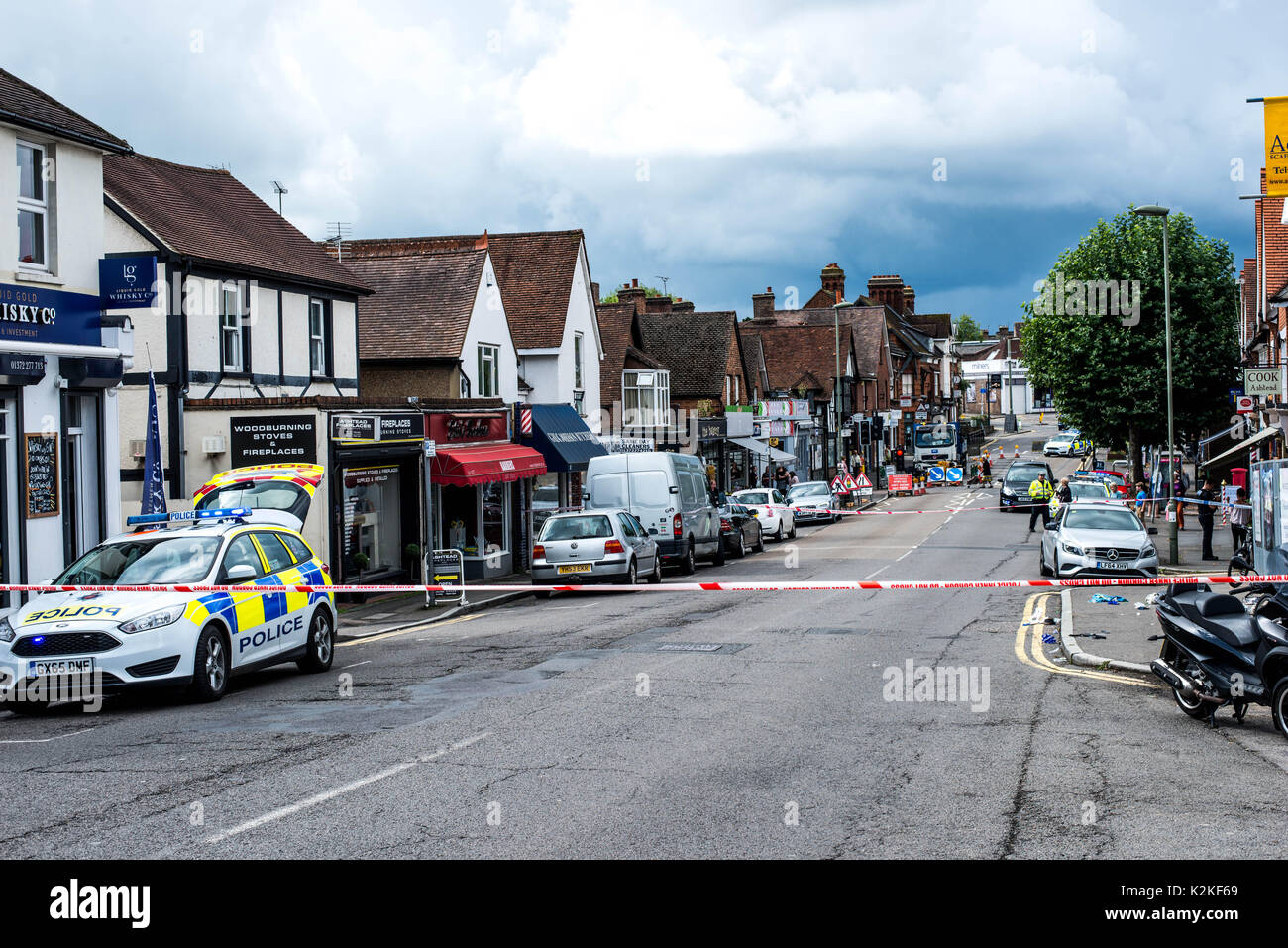 The Street, Ashtead, Surrey, United Kingdom, 31st August 2017. Emergency Serives Attend the scene of a serious Road Traffic Accident, Including a HEMS Air Ambulance. A woman in her 70s' sustained serious and life threatening head injuries after being hit by a motorbike and was transferred, by road, to St.Georges Hospital in Tooting, South London. - Stock Image