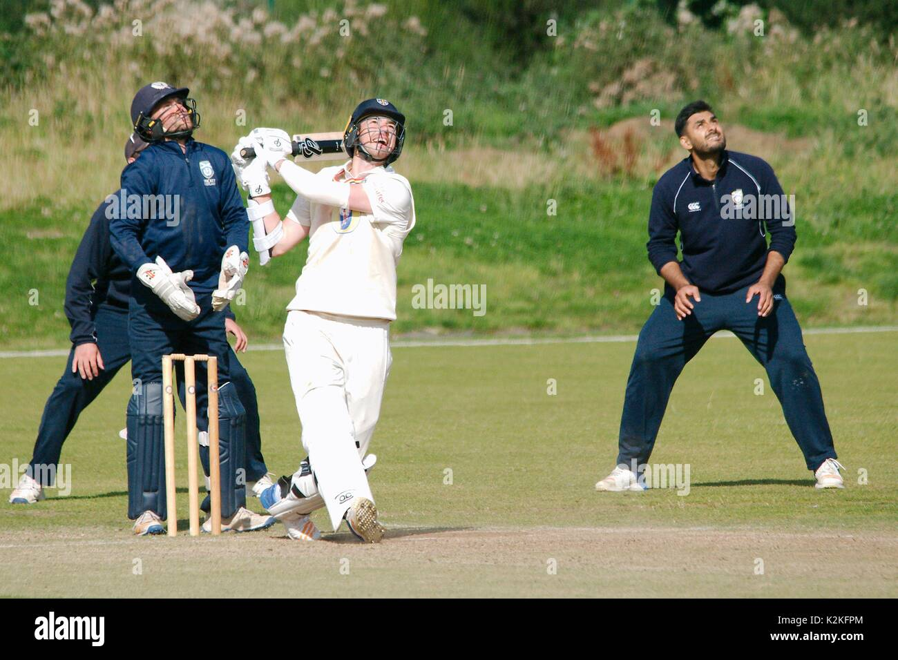 Burnopfield, UK. 31st Aug, 2017. James Weighell, batting for Durham CCC 2nd XI against Scotland A at Burnopfield Cricket Club, watches the ball which is caught by a Scottish fielder. Credit: Colin Edwards/Alamy Live News - Stock Image