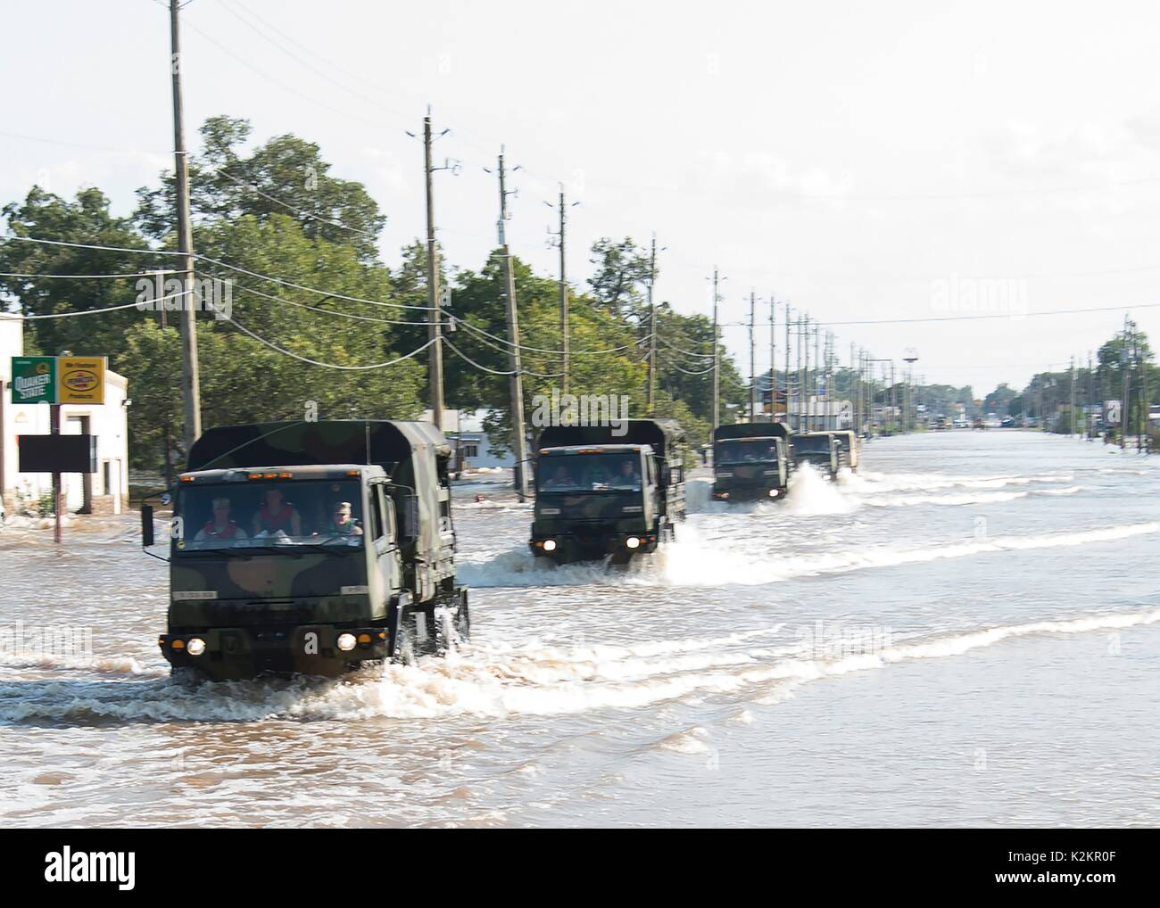Wharton, United States. 31st Aug, 2017. National Guardsmen drive Light Medium Tactical Vehicles through flood waters as they evacuate stranded residents in the aftermath of Hurricane Harvey August 31, 2017 in Wharton, Texas. Credit: Planetpix/Alamy Live News - Stock Image