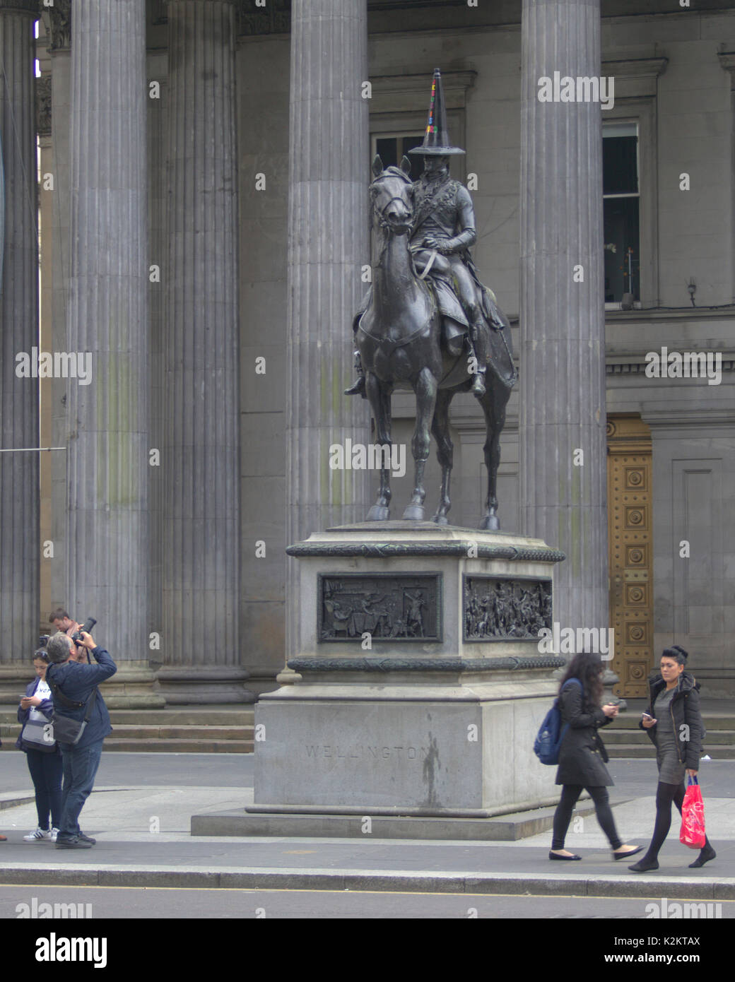 """Glasgow, Scotland, UK. 01st Sep, 2017. After the recent pride march and homophobic protests in the city the iconic and famous Duke of Wellington statue cone head outside the museum of Modern Art has a new headgear. Rainbow letters adorn a Black cone with the Words """"Jesus is Lord'. It often has a new cone placed on it overnight by unknown individuals and this one replaced a previous one, a rainbow coloured come supporting the recent gay pride week in the city.It is being perceived as a reply to this from a religions person. Credit: gerard ferry/Alamy Live News - Stock Image"""