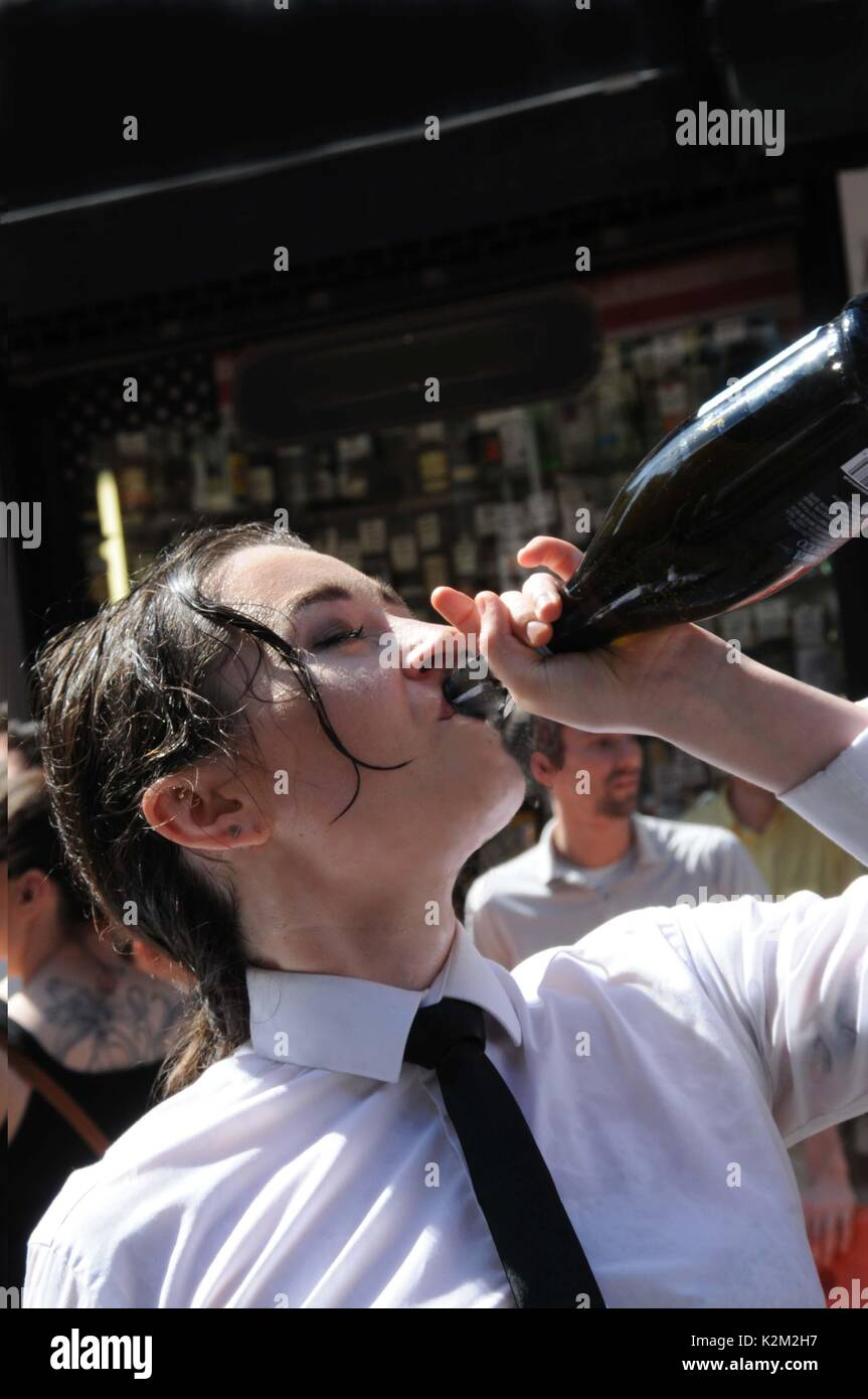 A Waitress drinking Champagne, after The Soho Waiters' Race. - Stock Image