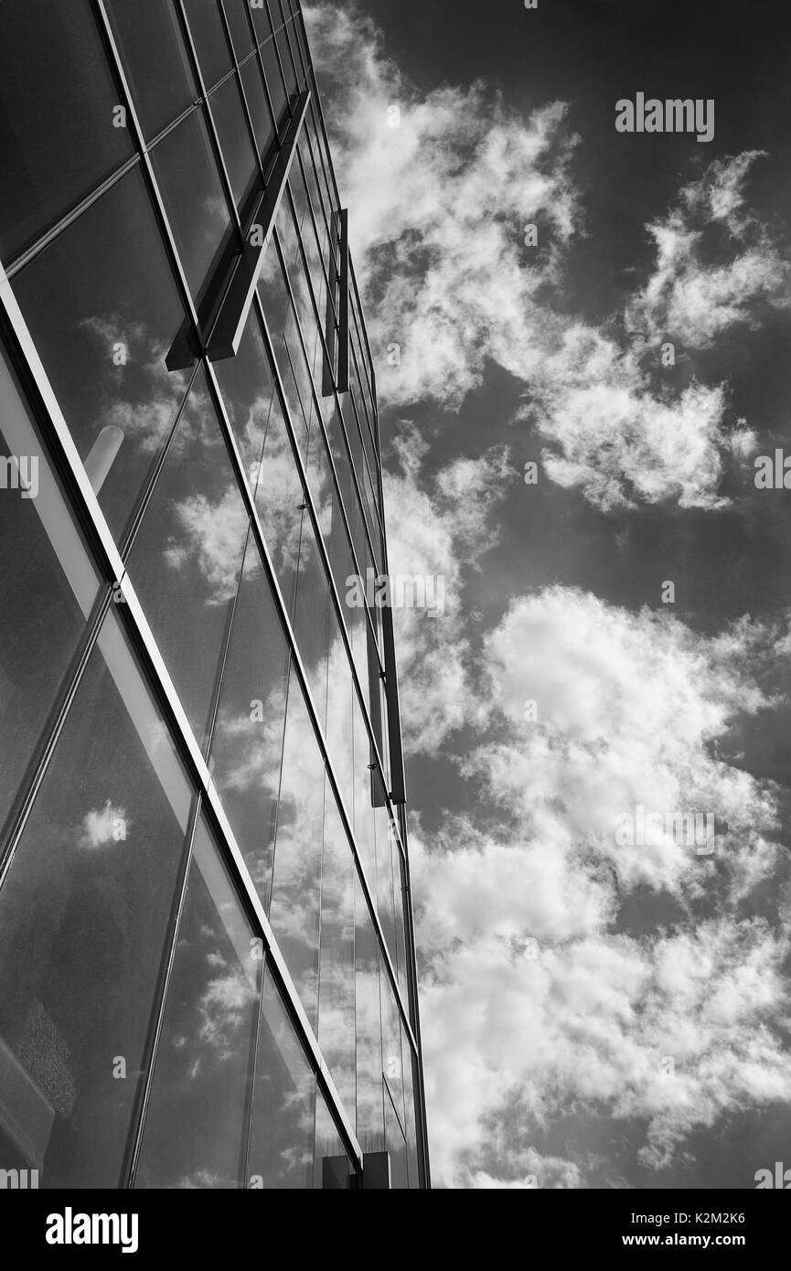 high-rise reflecting cloudy sky Stock Photo