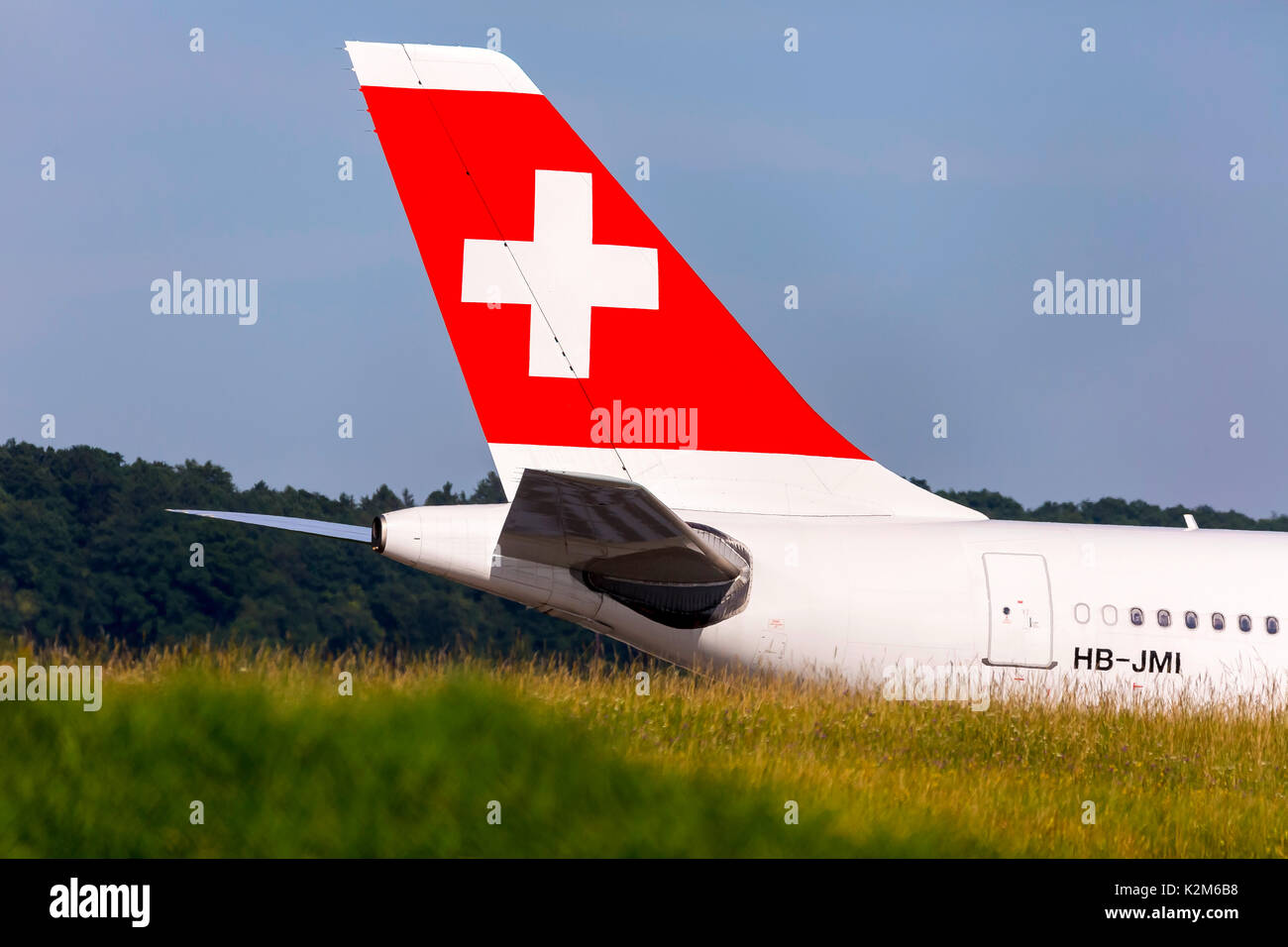 Zurich Airport, ZRH. Airplane Airbus A340, Swiss,  Aircraft registration HB-JMI. - Stock Image