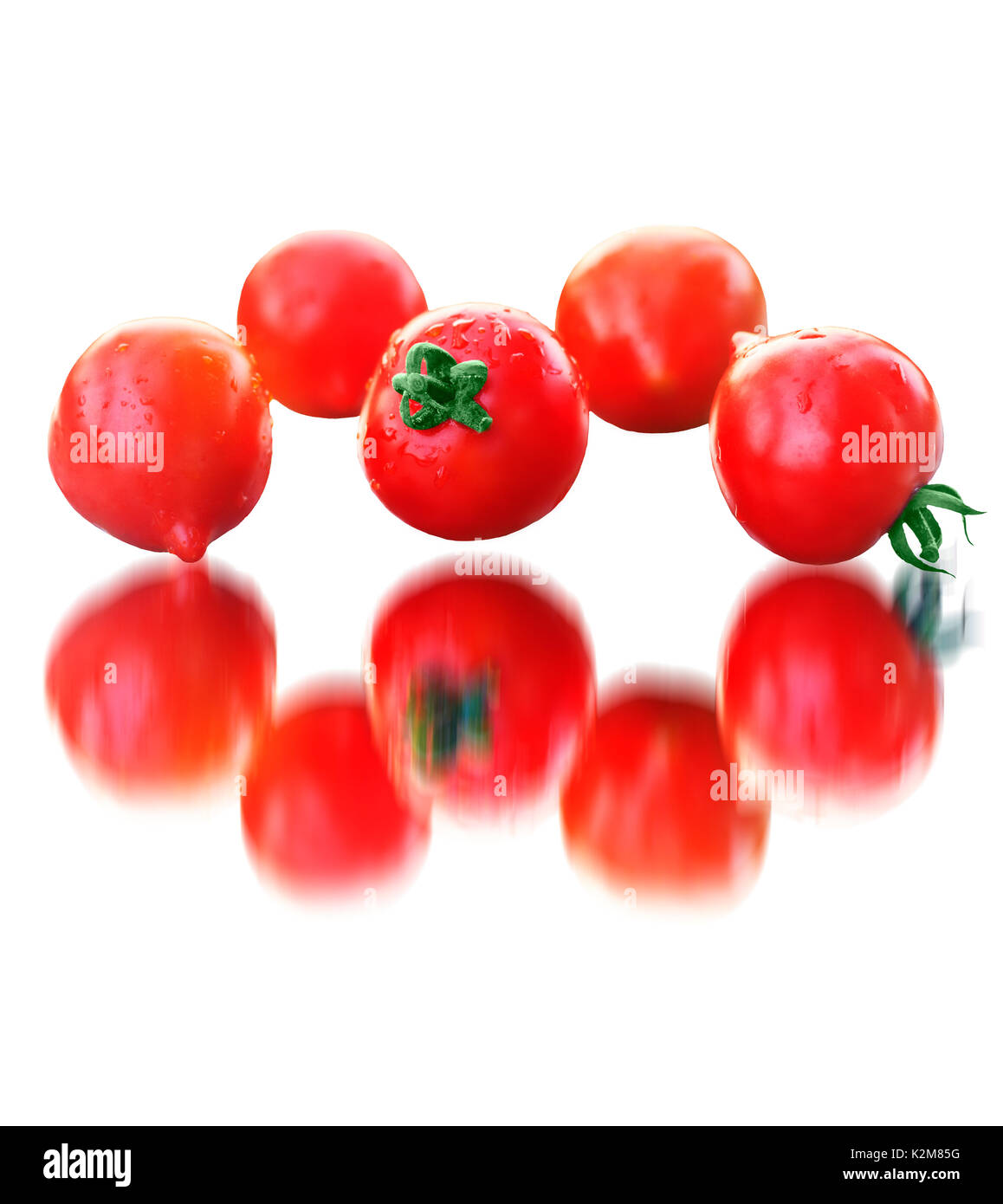 tomato kaleidoscope on a white background - Stock Image