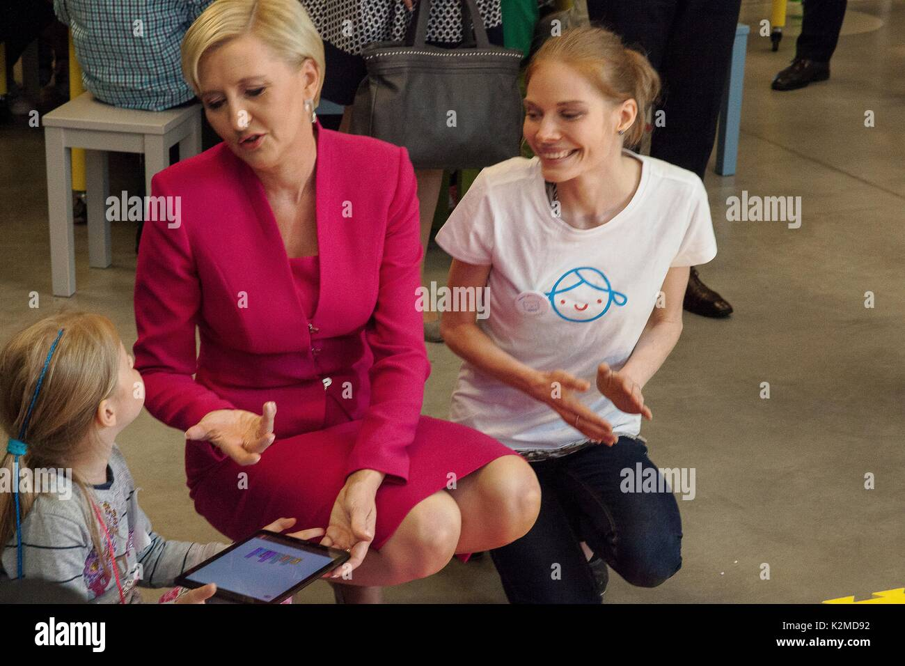 Polish First Lady Agata Kornhauser-Duda, with students during a visit the Copernicus Science Center July 6, 2017 in Warsaw, Poland. - Stock Image