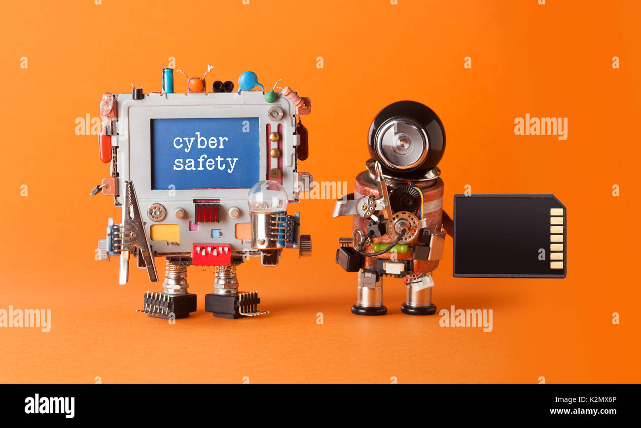 Cyber safety internet crime security concept. Alert message hacked computer. Robotic IT specialist memory card antivirus software. Orange background, shallow depth field - Stock Image
