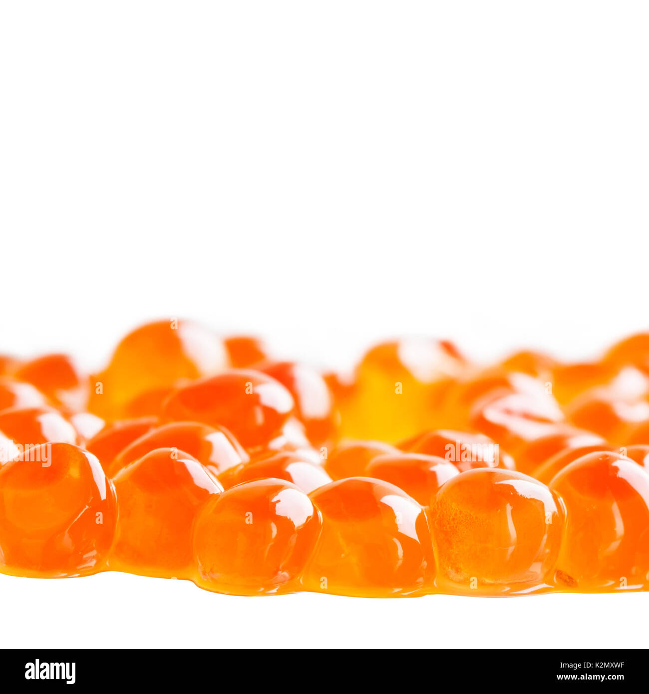 Red caviar on white background. Tradition salmon fish delicatessen healthy food macro view. Shallow depth of field, - Stock Image