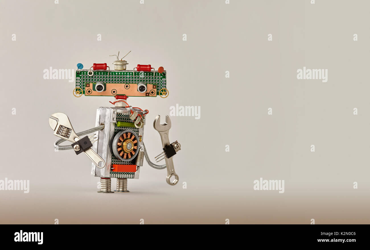 Automation robotic process concept. Hand wrench adjustable spanner handyman on beige gradient background. Friendly robot toy character made of electronic circuits, chip circuits resistors. Copy space - Stock Image