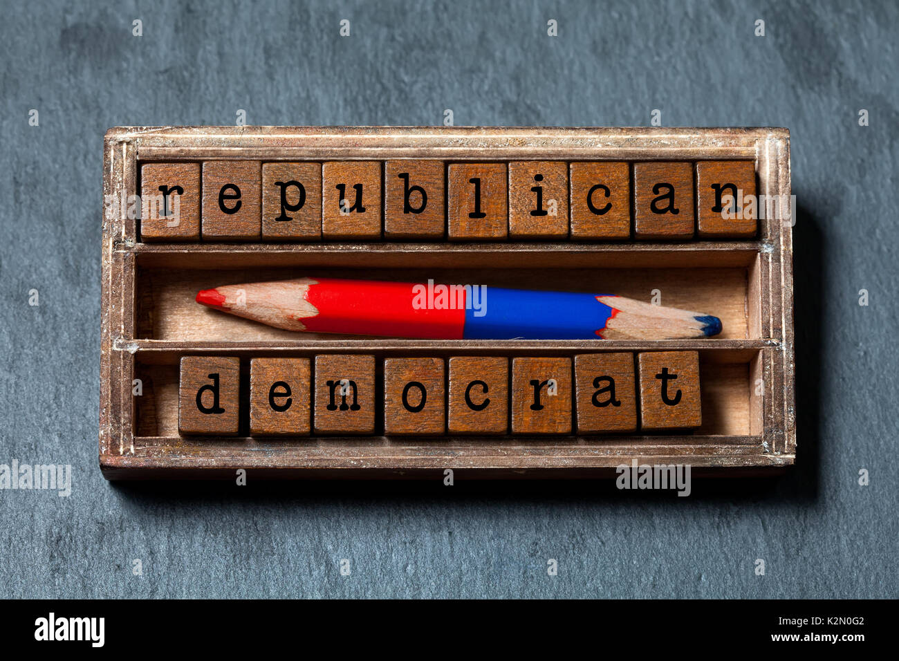 Republican democrat politic alternative choice concept. Vintage box, wooden cubes phrase with old style letters, - Stock Image