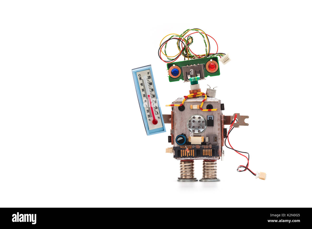 Weather forecaster robot with thermometer displaying room temperature thermal comfort level. Climate control concept photo. Copy space white background. - Stock Image