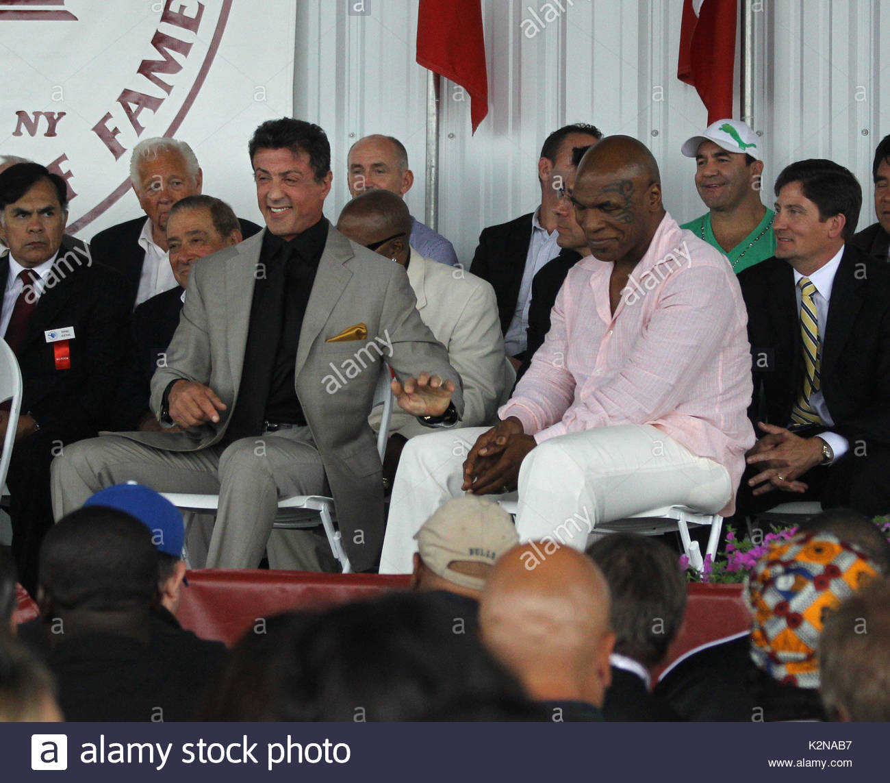 Mike tyson and sylvester stallone mike tyson and sylvester stallone mike tyson and sylvester stallone mike tyson and sylvester stallone have fun on stage at the boxing hall of fame together as they were inducted into the m4hsunfo