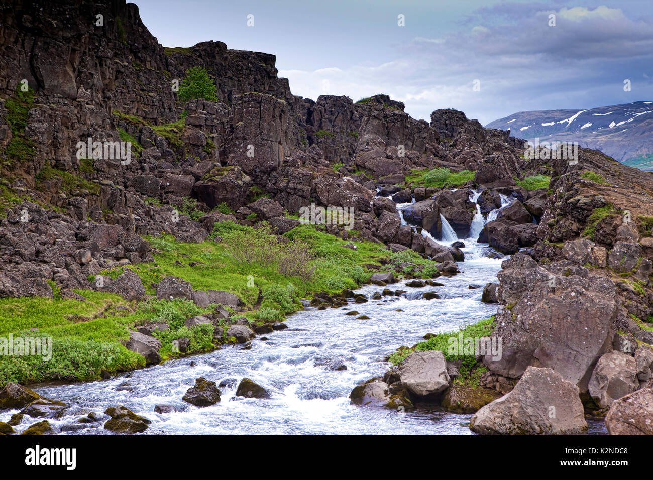 Small waterfall along the Ring Road in Iceland. - Stock Image